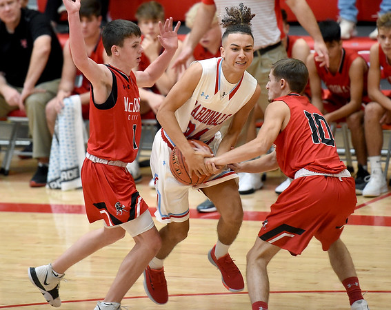 Webb City's Cohl Vaden (24) fights to get past McDonald County's Pierce Harmon (1) and Koby McAllister (10) during their game on Tuedday night at Webb City.<br /> Globe   Laurie Sisk