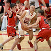 Webb City's Cohl Vaden (24) fights to get past McDonald County's Pierce Harmon (1) and Koby McAllister (10) during their game on Tuedday night at Webb City.<br /> Globe | Laurie Sisk