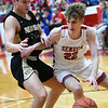 Seneca's Isaiah Grotjohn, right, tries to get past Neosho's Dalton Brodie during their game on Friday night at Seneca.<br /> Globe | Laurie Sisk
