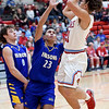 Webb City's Nickhai Howard (21) puts up a shot as Parsons' Julius Smith-Reece (23) and Ethan Houk (0) defend during their game in the 4 States Challenge on Saturday night at Webb City.<br /> Globe | Laurie Sisk