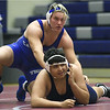 Carthage's Kale Schraeder, top, battles Joplin's Gunner Price during their match on Thursday night at Joplin High School.<br /> Globe | Laurie Sisk