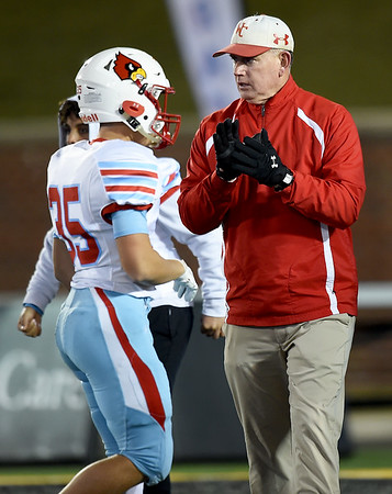 Webb City coach John Roderique watches his players warm up before the Cardinals Class 4 championship game in Columbia.<br /> Globe | Laurie Sisk