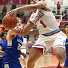 Webb City's Terrell Kabala (1) draws a foul on Carthage's Patrick Carlton (23) during their game on Tuesday night at the Cardinal Dome.<br /> Globe | Laurie Sisk