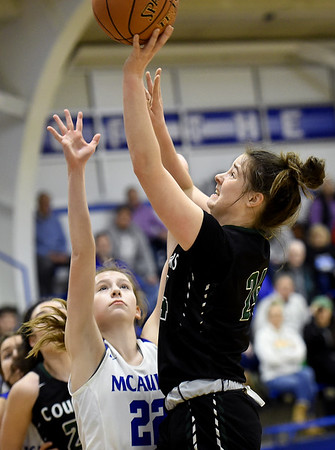 College Heights' Emmy Colin (24) shoots over McAuley's Kayleigh Teeter (22) during their game on Friday night at McAuley.<br /> Globe | Laurie Sisk