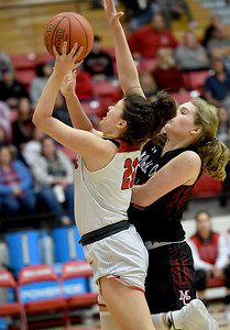 Carl Junction's Jessa Hylton (21) scores in transition as McDonald County's Jaylie Sannie (41) defends during their game on Thursday night at CJHS. Globe   Laurie SIsk
