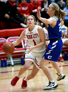 Webb City's Peyton Hawkins (1) drives to the basket as Carthage's Landry Cochran (23) defends during their game on Tuesday night at the Cardinal Dome. Globe   Laurie Sisk