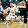 Missouri Southern's Megan Jackson (20) drives to the basket as Northwest's Kendey Eaton (5) defends during their game on Thursday night at Leggett & Platt.<br /> Globe | Laurie SIsk