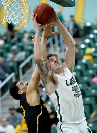Missouri Southern's Cam Martin (31) drives for a score as Missouri Western's Alex John defends during their game on Saturday at Leggett & Platt.<br /> Globe | Laurie Sisk