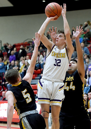Thomas Jefferson's Chase Kellenberger (32) shoots between Purdy defenders Clay Henderson (5) and Osiel Aldava (44) during their Class 2 District 12 championship game on Friday night at Webb City High School.<br /> Globe | Laurie Sisk
