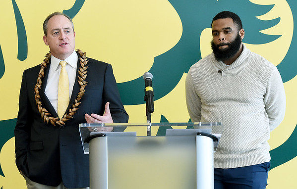 From the left: Missouri Southern football coach Jeff Sims speaks about the results of recruiting efforts during a press conference on Thursday as recruiting coordinator Dan McKinney looks on. Sims is donning a necklace he brought back from American Samoa during one of his visits there.<br /> Globe   Laurie Sisk
