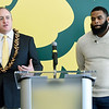 From the left: Missouri Southern football coach Jeff Sims speaks about the results of recruiting efforts during a press conference on Thursday as recruiting coordinator Dan McKinney looks on. Sims is donning a necklace he brought back from American Samoa during one of his visits there.<br /> Globe | Laurie Sisk