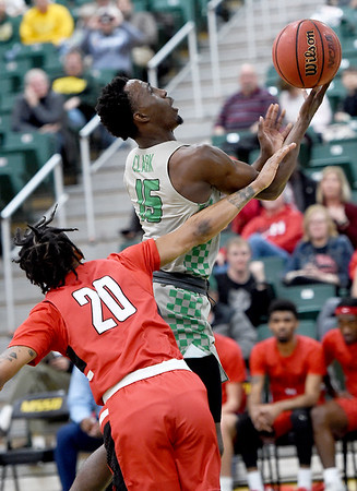 Missouri Southern's Elyjah Clark (15) drives to the basket and draws a foul on Central Missouri's Walter Sorrels, Jr. (20) during their game on Wednesday night at Leggett & Platt.<br /> Globe   Laurie SIsk