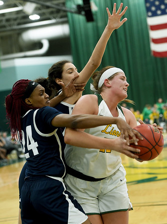 Missouri Southern's Jordan Schoenberger, right, battles Lincoln's Vivian Chigbu (24) and Anna Munoz Vidueira during their game on Saturday at Leggett & Platt.<br /> Globe | Laurie Sisk