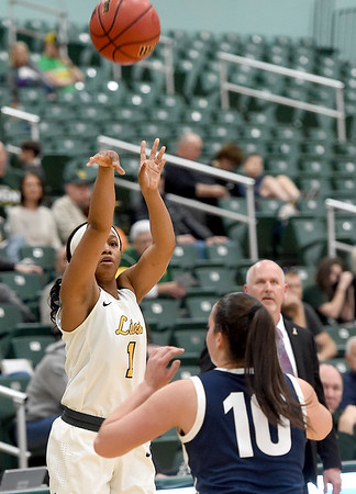 Missouri Southern's Destiny Cozart (1) hits one of her six three-pointers as Lincoln's Faith Brintle (5) defends during their game on Saturday at Leggett & Platt.<br /> Globe | Laurie Sisk