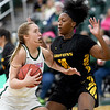Missouri Southern's Zoe Campbell drives to the basket as Missouri Western's Corbyn Cunningham (30) defends during their game on Saturday at Leggett & Platt.<br /> Globe | Laurie Sisk