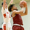 Joplin's Zach Westmoreland (1) gets past Carl Junction's Isaac Hoberecht (2) for a score during their game on Tuesday night at CJHS.<br /> Globe   Laurie Sisk
