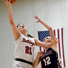 Carl Junction's Jessa Hylton (21) drives to the basket as Joplin's Gabriella Quinn (12) defends during their game on Tuesday night at CJHS.<br /> Globe   Laurie Sisk