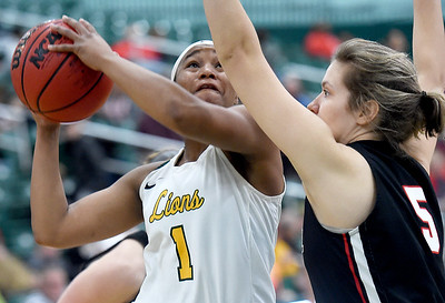 Missouri Southern's Destiny Cozart (1) tries to score over Central Missouri's Sydnee Schovanec (5) during their game on Wednesday night at Leggett & Platt. Globe   Laurie SIsk