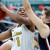 Missouri Southern's Destiny Cozart (1) tries to score over Central Missouri's Sydnee Schovanec (5) during their game on Wednesday night at Leggett & Platt.<br /> Globe | Laurie SIsk