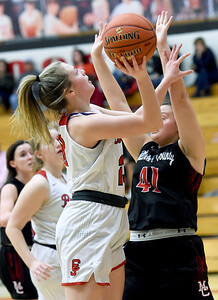 Carl Junction's Destiny Buerge (23) drives to the basket as McDonald County's Jaylie Sannie (41) defends during their game on Thursday night at CJHS. Globe   Laurie SIsk