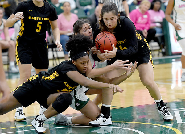 Missouri Southern's Layne Skiles, center, battles Missouri Western's Corbyn Cunningham, left and Kylee Williams, right, for a loose ball during their game on Saturday at Leggett & Platt.<br /> Globe   Laurie Sisk