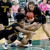 Missouri Southern's Layne Skiles, center, battles Missouri Western's Corbyn Cunningham, left and Kylee Williams, right, for a loose ball during their game on Saturday at Leggett & Platt.<br /> Globe | Laurie Sisk