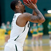 Missouri Southern's Braelon Walker lines up a 3-point shot during the Lions game against Rogers State on Saturday at Leggett & Platt.<br /> Globe | Laurie Sisk