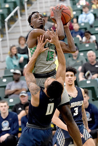 Missouri Southern's Elyjah Clark (15) drives to the basket as Cameron Potts (0) defends during their game on Saturday at Leggett & Platt. Globe   Laurie Sisk