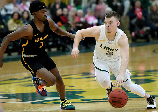 Missouri Southern's Parker Jennings, right, fights to get past Missouri Western's Tyrell Carroll during their game on Saturday at Leggett & Platt.<br /> Globe   Laurie Sisk
