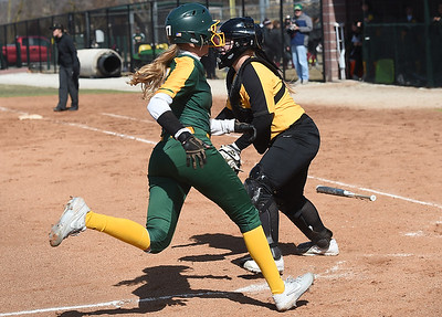 Missouri Southern's Tori Frazier crosses home plate as Missouri Western catcher  Chloe Armstrong awaits the throw during their game in the 15th Annual Teri Mathis Zenner Memorial Classic on Friday afternoon at Pat Lipira Field. Globe   Laurie Sisk