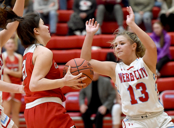 Carl Junction's Jessa Hylton (21) drives to the basket as Webb City's Darcy Darnell (13) defends during their game on Tuesday night at WCHS.<br /> Gklobe | Laurie Sisk