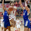 Webb City's Terrell Kabala (1) splits Carthage defenders Taris Jackson (2) and Alex Martini (32) during their game on Tuesday night at the Cardinal Dome.<br /> Globe | Laurie Sisk