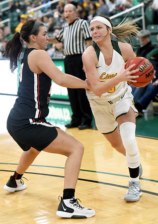 Missouri Southern's Brooke Stauffer (13) tries to get past Central Missouri's Megan Skaggs (20) during their game on Wednesday night at Leggett & Platt.<br /> Globe   Laurie SIsk