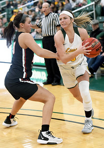 Missouri Southern's Brooke Stauffer (13) tries to get past Central Missouri's Megan Skaggs (20) during their game on Wednesday night at Leggett & Platt. Globe   Laurie SIsk