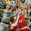 Missouri Southern's Christian Bundy (14) and Kinzer Lambert, right battle Central Missouri's Michael Winger (12) and Matt Wilkinson (22) for a rebound during their game on Wednesday night at Leggett & Platt.<br /> Globe | Laurie SIsk