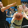 Ozark Christian's Makenzie Purinton (1) tries to split Central Christian defenders Lauren Mills (33) and Alexis Whisenand, right, during their first round game of the Midwest Christian College Conference tournament on Thursday night at OCC.<br /> Globe   Laurie Sisk