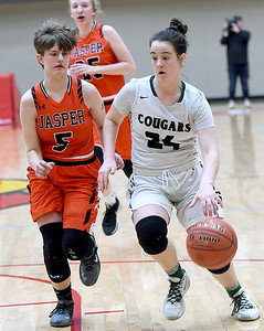 College Heights' Emmy Colin (24) drives past  Jasper's Sydney Webb (5) during their Class 2 District 12 championship game on Friday night at Webb City High School. Globe | Laurie Sisk