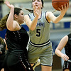 Ozark Christian's Annie Jaycox (5) shoots as Central Chrstian's Elizabeth Willouer (2) defends during their first round game of the Midwest Christian College Conference tournament on Thursday night at OCC.<br /> Globe   Laurie Sisk
