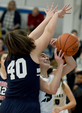 College Heights' Lainey Lett (25) drives to the basket as Providence's Abigail Russell (40) defends during the championship game at the McAuley Warrior Classic on Saturday at McAuley.<br /> Globe | Laurie Sisk
