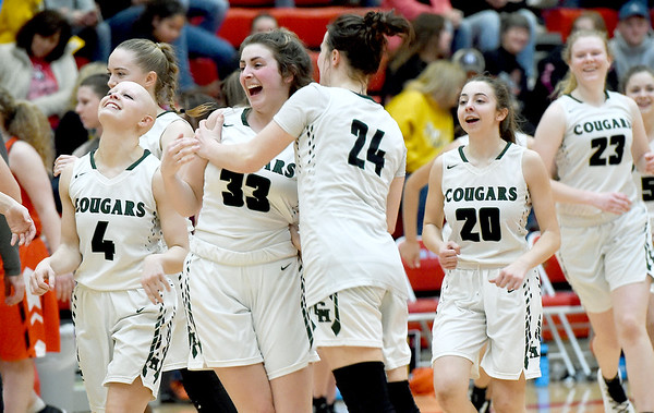 The College Heights girls basketball team celebrates its Class 2 District 12 championship game victory over Jasper on Friday night at Webb City High School.<br /> Globe | Laurie Sisk