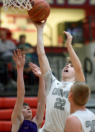 College Heights' Connor Burton (22) shoots over Verona's Dillin Shrum, left, during their Class 2 District 12 opener on Saturday at Webb City High School.<br /> Globe | Laurie SIsk