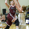 Joplin's Jessica Zengel (14) drives the lane as Neosho's Makayla Hayes (11) defends during the Eagles' season opener on Tuesday night at NHS.<br /> Globe | Laurie Sisk