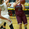 Joplin's Andi Wilson (30) drives past Neosho's Emilee Anderson (10) during the Eagles' season opener on Tuesday night at NHS.<br /> Globe | Laurie Sisk