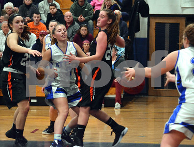Photo by Albert J. Marro   Otter Valley's Courtney Bushey (3) makes a nice bounce pass to teammate Sophie Markowski (rigfht) during Friday's game against Middlebury in Brandon. On defense for the Tigers are Keragan Dunbar (23) and Riley Fenster (24).