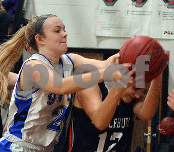Photo by Albert J. Marro   Otter Valley's Sophia Bloomer, left, battles Middlebury's Calista Carl (12)  for a rebound during Friday's game in Brandon.