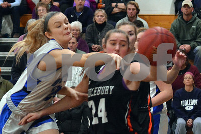 Photo by Albert J. Marro   Otter Valley's Sopghia Bloomer, left, battles Middlebury's Riley Fenster for a rebound during Friday's game at Otter Valley in Brandon.