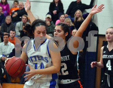 Photo by Albert J. Marro   Otter Valley's Gabriela Poalino (10) looks to drive on Middlebury's Calista Carl (12) during Friday's game at  in Brandon.