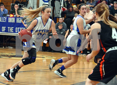 Photo by Albert J. Marro   Otter Valley's Sophia Bloomer, left,drives the lane during Friday's game against Middlebury  in Brandon.