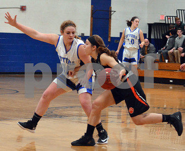 Photo by Albert J. Marro   Mi9ddlebury's Keagan DFunbar (23) leans into Otter valley's Sophie Markowski and drives by down the lane during Friday's in Brandon.
