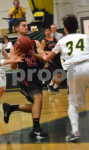 Photo by Albert J. Marro   Twin Valley's Skyler Boyd (21) drives down the lane and picks up a foul by West Rutland's Drake Jankowski (34) during Saturday's game in Westside. Twin Valley pulled away in the fourth quarter and won 60-42. Boyd scored 30 points.